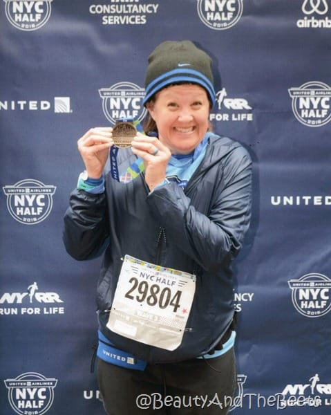 medal pose United Airlines Half Marathon Beauty and the Beets