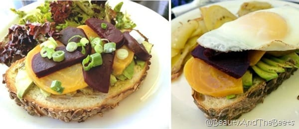 one slice of toast with avocado, red and gold beets, and green onions on a white plate