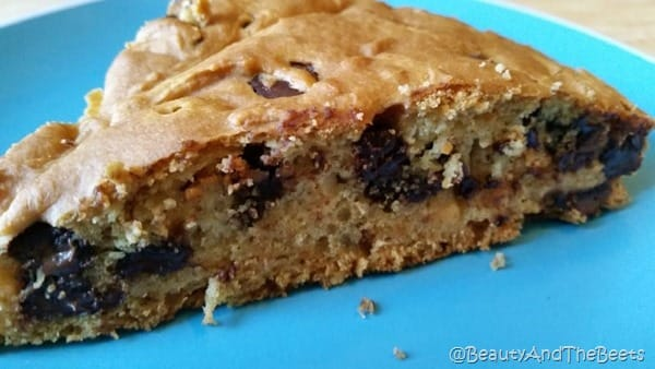 a fluffy slice of Vegan chocolate chip breakfast cake on a blue plate