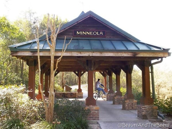 a wooden gazebo with Minneola sign on it along the West Orange Trail