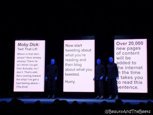 the Blue Man Group in between giant pages of Moby Dick
