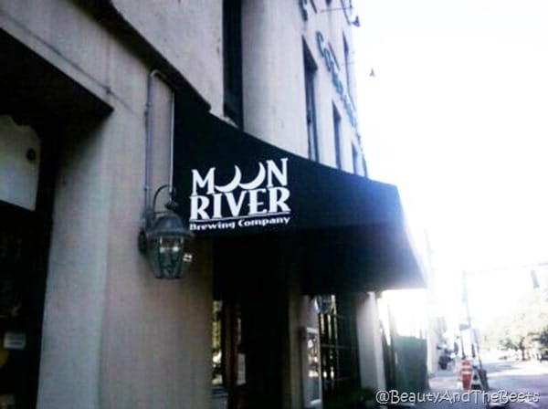 the awning of the Moon River Brewing Company on a street in Savannah