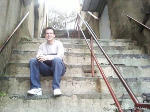 Mr Beet sitting on steep steps and a metal railing