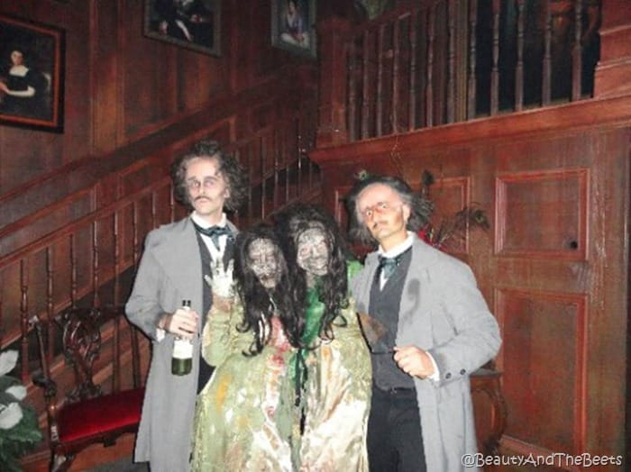 two Virginia zombies and two Edgar Allan Poes posing in the library