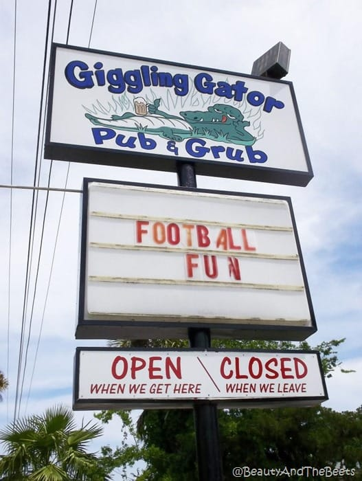 the marquee of the giggling gator pub sign reading open when we get here and closed when we leave