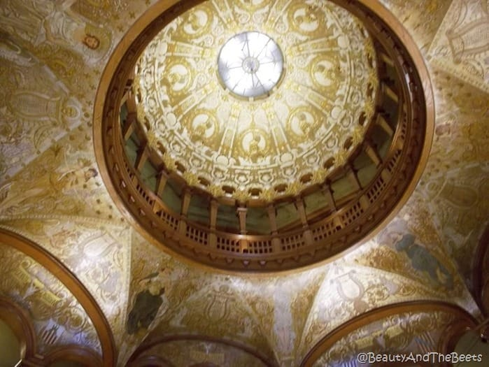 the camera looking up at a well ormanated gold dome