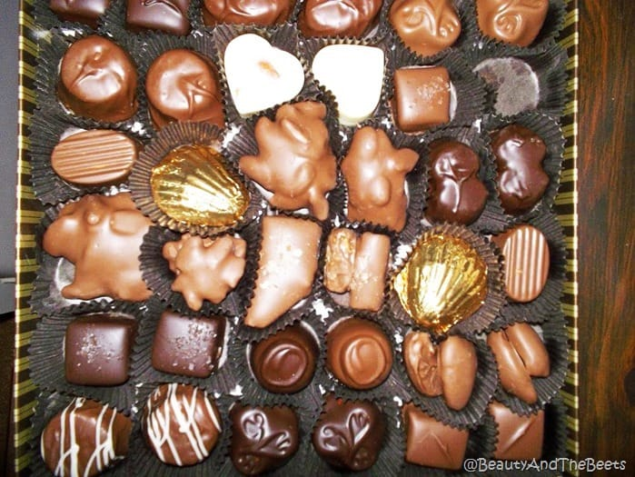 a box of various chocolates in a black background from Whetstone Chocolates