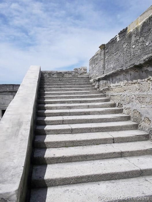 stone steps leading up to a bright blue sky