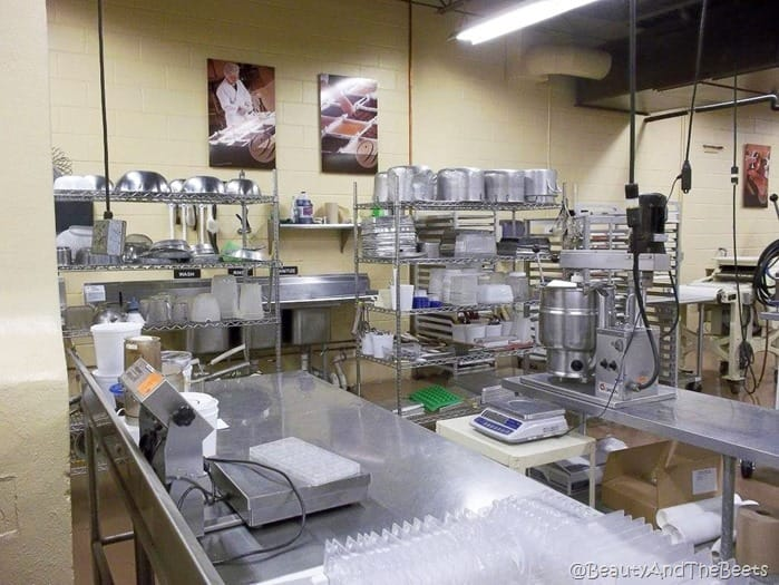 the stainless steel kitchen with shelves of bowls and baking sheets at Whetstone Chocolates