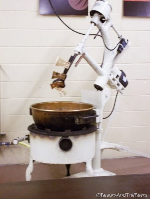 a white and copper industrial mixer on the factory floor