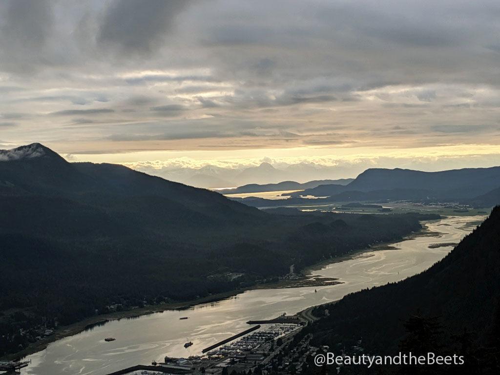 The sun sets over the Gastineau Channel and Juneau, Alaska